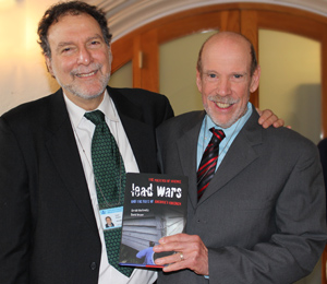 Authors David Rosner and Gerald Markowitz holding a copy of their latest book, Lead Wars